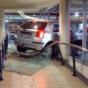 Car driven through window