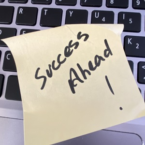 Success Ahead on Post It Note