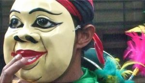 masked person in parade