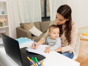 happy mother with baby working from home