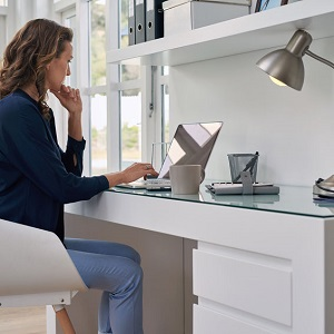 woman working on laptop computer form home