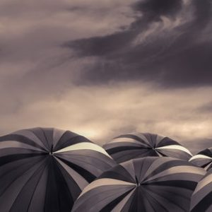 Hopeless Concept Black umbrellas and dark sky