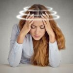 Woman with vertigo, suffering from dizziness