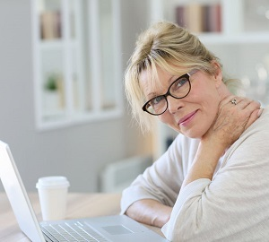 confident mature woman at a computer
