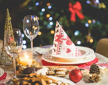 food and decorations on table for Christmas meal