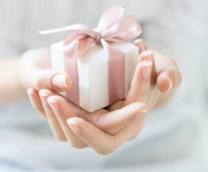 Woman holding wonderful things in gft box
