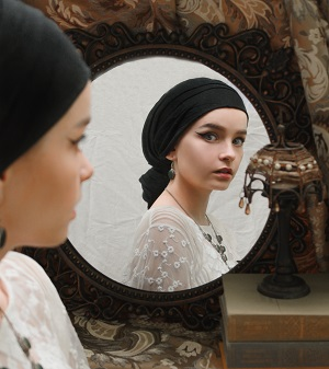 woman looking in mirror - waking up concept