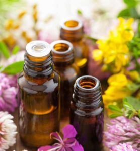 essential oils amber bottles with flowers