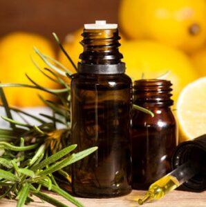Lemon essential oil and rosemary leaves